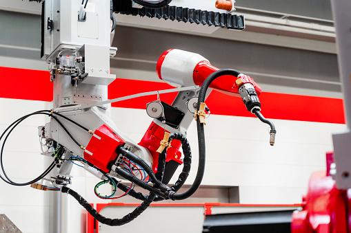 Robotics「Close-up of welding robotic arm in factory」:スマホ壁紙(15)