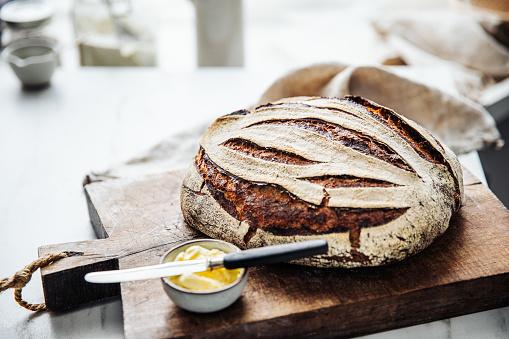 Sourdough Bread「Close-up of sourdough bread and butter on counter」:スマホ壁紙(7)
