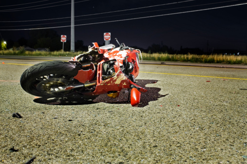 Crash「Close-up of wrecked red motorcycle on side of road」:スマホ壁紙(6)