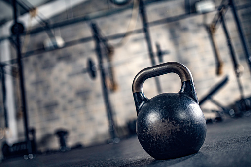 Barbell「Close-up of kettlebell on the floor in a gym.」:スマホ壁紙(8)