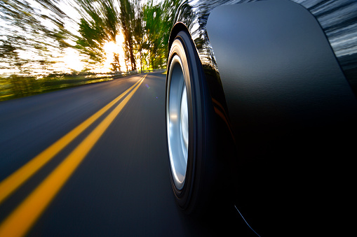 Hairpin Curve「Ground view of car tire speeding along country road sunset」:スマホ壁紙(3)