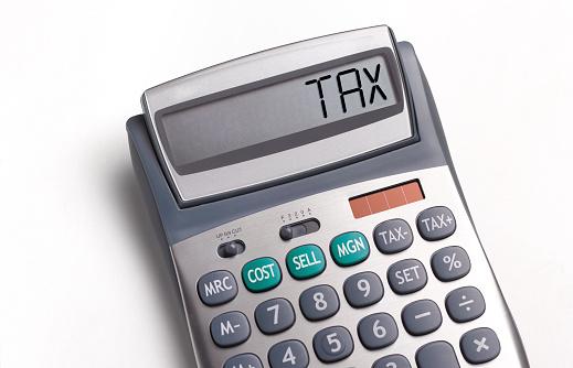 Tax「Tax written on a calculator」:スマホ壁紙(19)