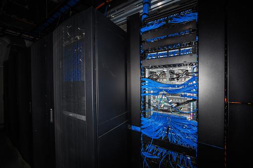Data Center「Server room racks glowing from behind」:スマホ壁紙(12)