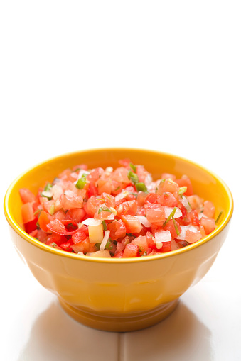 Salsa Sauce「Yellow bowl of salsa on a white background」:スマホ壁紙(11)
