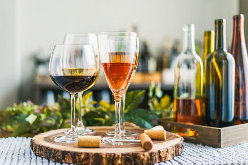 Tasting「Indoor wine tasting with various bottles of wine and glasses」:スマホ壁紙(3)