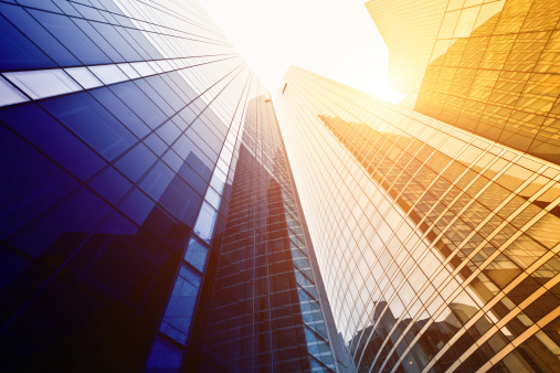 Corporate Business「Looking up at tall buildings with sun shining down」:スマホ壁紙(5)