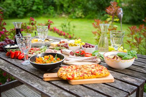 Abundance「Variety of Mediterranean antipasti on garden table」:スマホ壁紙(18)