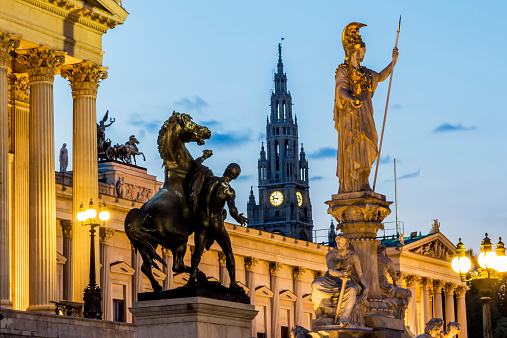 God「Austria, Vienna, view to parliament building, town hall tower and statue of goddess Pallas Athene by twilight」:スマホ壁紙(1)