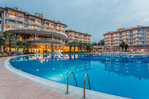 Resort Swimming Pool「Luxury resort hotel with Swimming Pool at sunset」:スマホ壁紙(12)
