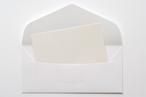 Message「Opened white envelope with blank card on white background」:スマホ壁紙(11)