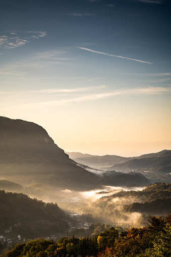 Piedmont - Italy「Sunrise morning mist in small village on the Italian Alps, Piedmont, Monte Fenera」:スマホ壁紙(2)