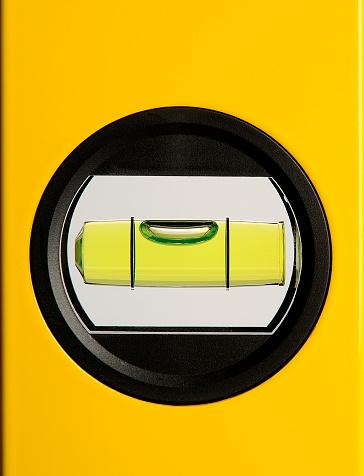 Carpentry「Circular bubble level on a yellow background」:スマホ壁紙(3)