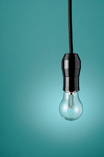 Cable「LED light bulb against blue background with copy space」:スマホ壁紙(9)