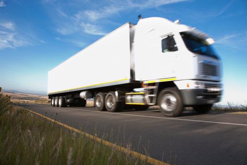 Transportation「Semi-truck driving on remote road」:スマホ壁紙(6)