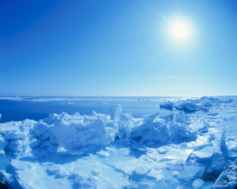 Hokkaido「Sun Shining in the Sky Above Piles of Drift Ice. Hokkaido, Japan」:スマホ壁紙(1)