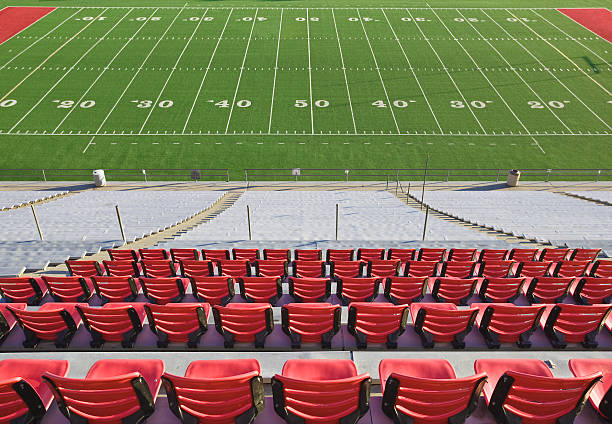 Empty football field and stadium seats.:スマホ壁紙(壁紙.com)