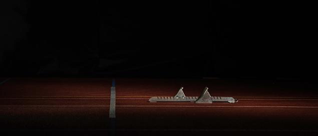 Part of a Series「Track starting blocks on running track」:スマホ壁紙(18)