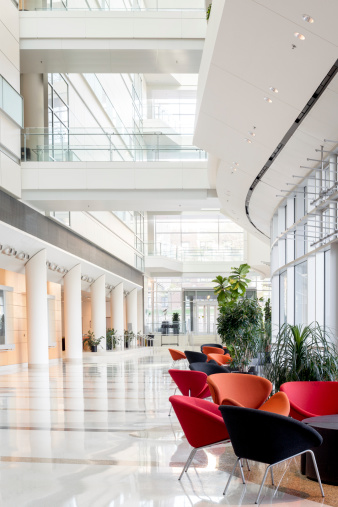 Postmodern「View of an office building lobby with colorful chairs」:スマホ壁紙(1)