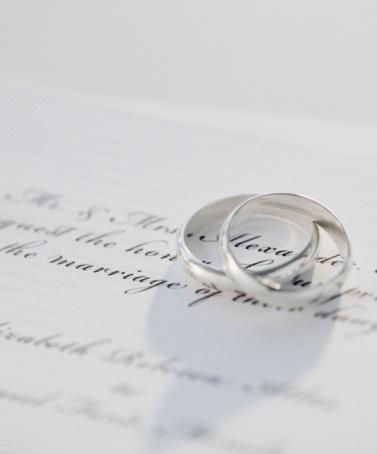 Wedding Invitation「Two wedding rings on marriage certificate, studio shot」:スマホ壁紙(8)
