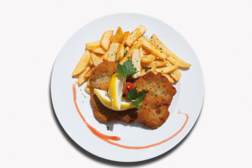 Beef「Close up of Viennese Schnitzel with french fried potatoes against white background」:スマホ壁紙(11)