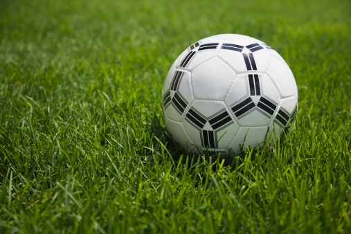 Weekend Activities「Close up of soccer ball on grass」:スマホ壁紙(4)