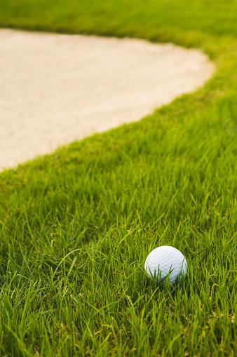 Sand Trap「Close up of golf ball near sand trap on golf course」:スマホ壁紙(4)