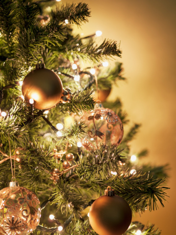 Vertical「Close up of Christmas ornaments on tree」:スマホ壁紙(5)