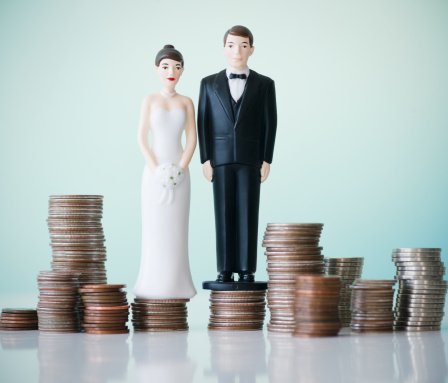 Married「Close up of wedding cake figurines on stacks of coins」:スマホ壁紙(16)