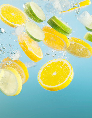 Slice of Food「Close up of sliced lemons and limes splashing in water」:スマホ壁紙(18)
