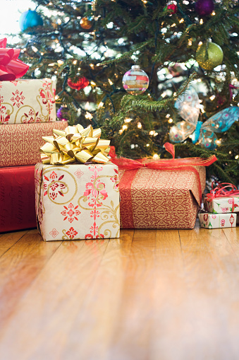Christmas Paper「Close up of wrapped gifts under Christmas tree」:スマホ壁紙(15)