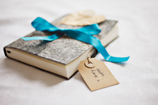 Diary「Close up of book tied with ribbon and gift tag」:スマホ壁紙(2)