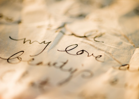 Writing「Close up of antique love letter on parchment 」:スマホ壁紙(10)