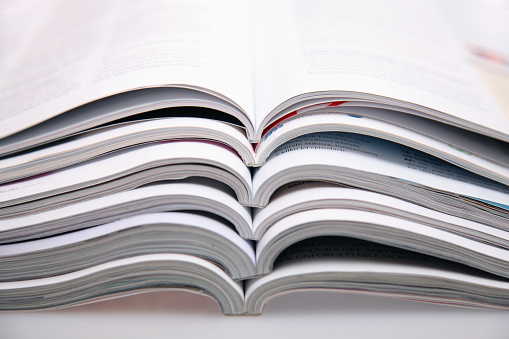 Printout「A bunch of open magazines stacked on top one another」:スマホ壁紙(15)