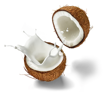 Halved「Two halves of a coconut and splashing coconut milk in front of white background」:スマホ壁紙(4)