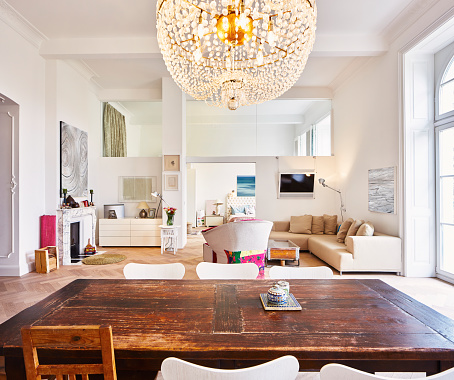 Chandelier「Living room in a refurbished old building with dining table in the foreground」:スマホ壁紙(0)