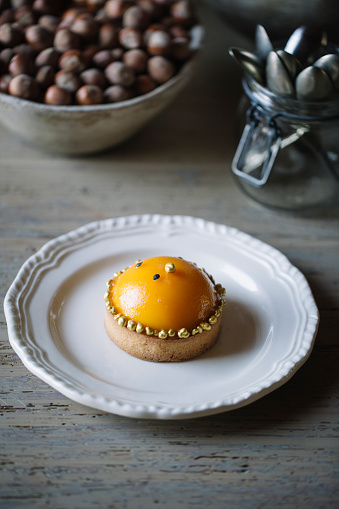 Dessert「Decorated tarlet with peach half on plate」:スマホ壁紙(17)
