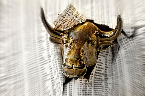 Aggression「Charging Bull Looking Through Torn Page of Financial Newspaper.」:スマホ壁紙(10)