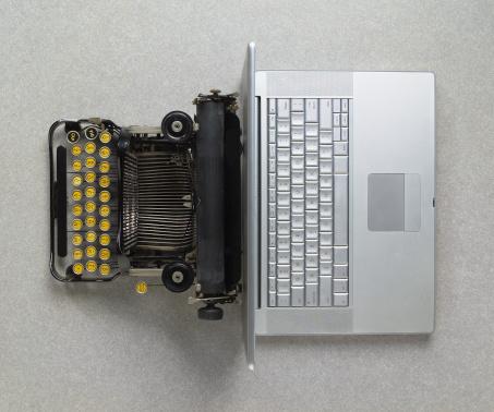 Contrasts「Classic analog typewriter vs Modern digital hi-tech laptop computer」:スマホ壁紙(2)