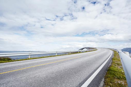The Way Forward「Empty road with distant bridge, Atlantic road, Norway」:スマホ壁紙(6)