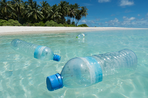 Island「Plastic bottles floating in sea off tropical island」:スマホ壁紙(14)