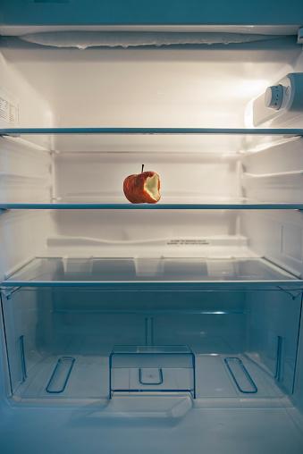 Refrigerator「Nearly empty fridge with a seared bitten apple」:スマホ壁紙(14)