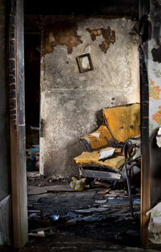 Inferno「Burnt, Damaged Interior of Home with Destroyed Chair and Books」:スマホ壁紙(0)