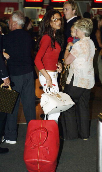Gareth Cattermole「David Beckham And His Wife Victoria Arrive At Heathrow Airport」:写真・画像(0)[壁紙.com]