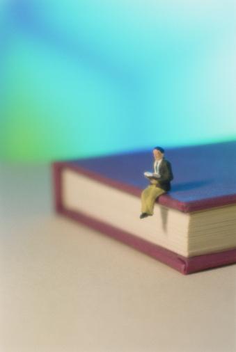 University Student「Figurine reading, sitting on giant book」:スマホ壁紙(19)