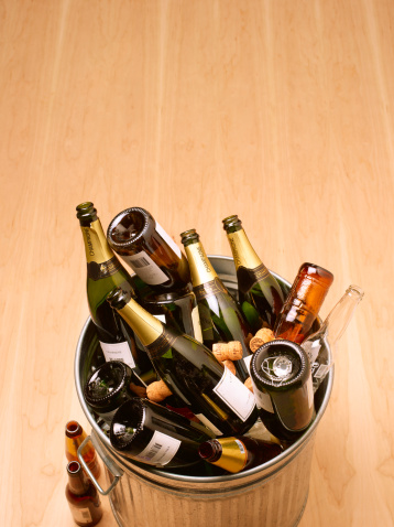 Recycling「Waste bin full of empty champagne bottles on wooden floor,  high angle view」:スマホ壁紙(10)