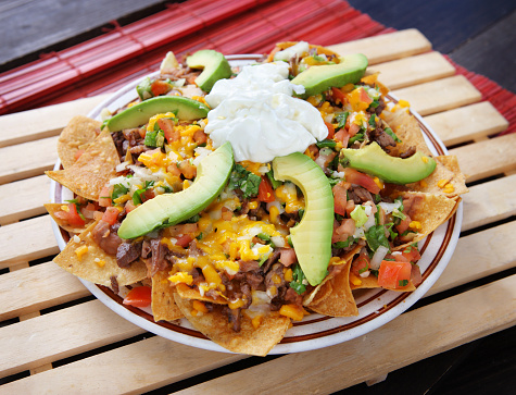 Mexico「Plate of nachos with avocado, cheese and vegetables」:スマホ壁紙(16)