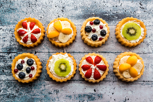 Dessert「Eight mini pies with whipped cream garnished with different fruits」:スマホ壁紙(0)