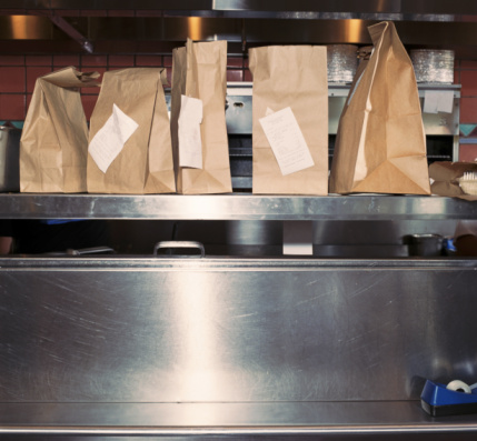 Take Out Food「Food in take out bags with receipts, sitting on restaurant shelf」:スマホ壁紙(4)