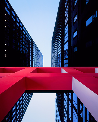 Surreal「Red architectural sculpture in front of modern office buildings」:スマホ壁紙(16)