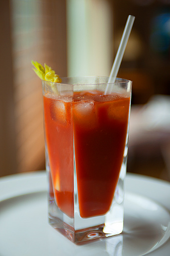 Bar - Drink Establishment「Bloody Mary cocktail in a tall crystal drinking glass with celery and a drinking straw at home or in a bar - drink establishment」:スマホ壁紙(2)